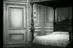 Wide shot of hand opening and closing bedroom door Stock Footage