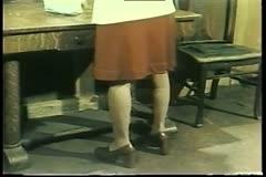 Rear view of lower half of woman wearing 1970s platform heels Stock Footage