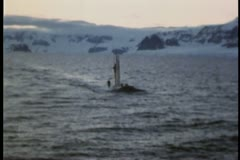 Submarine surfaces in arctic waters Stock Footage