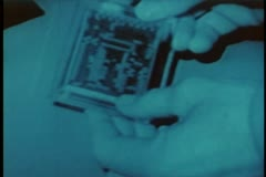 Close-up of hands scanning memory card Stock Footage
