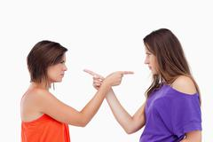 Teenagers pointing fingers on each other Stock Photos