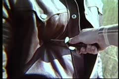 Close-up of hand with knife trying to stab man in leather jacket Stock Footage