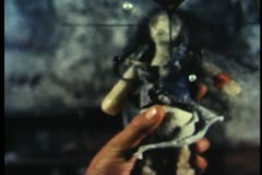 Close-up of hand holding voodoo doll - stock footage