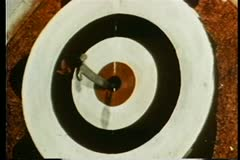 Close-up of knives in bullseye Stock Footage