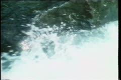 Water flowing down rocks in stream Stock Footage