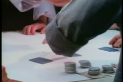 Medium shot of man smacking away hand during card game Stock Footage