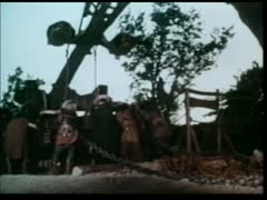 Barbarians loading catapult and firing Stock Footage