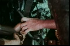 Close-up of hands trying to break chain with sword Stock Footage