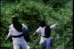 Masked men with swords running out of forest Stock Footage
