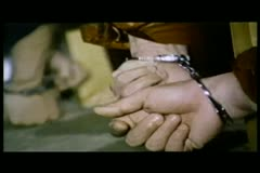 Close-up of men's hands in handcuffs trying to escape Stock Footage