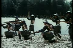 Ninjas firing muskets during shooting practice Stock Footage