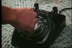 Close-up of a person dialing a rotary phone - stock footage