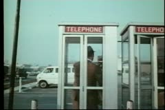 Man in telephone booth Stock Footage