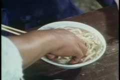 Close-up of person mixing noodles in soup Stock Footage
