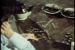 Medium shot of man arranging stones to create hieroglyphs Stock Footage