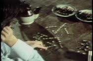 Medium shot of man arranging stones to create hieroglyphs Stock Footage