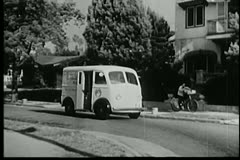 Milk truck driving along street Stock Footage