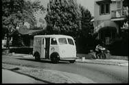 Milk truck driving along street Stock Footage