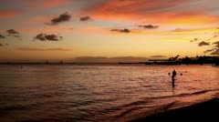 Children Silhoutte Playing at Tropical Waikiki Beach Sunset - stock footage