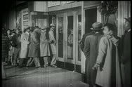 Line of people entering theater Stock Footage