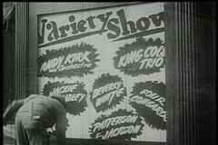 Rear view of worker putting up billboard for variety show Stock Footage