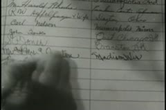 Close-up of person signing name in register - stock footage