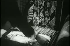 Medium shot of man packing suitcase - stock footage