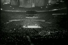 Long shot of spectators gathered for boxing match Stock Footage