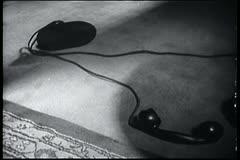 Telephone receiver lying on floor Stock Footage
