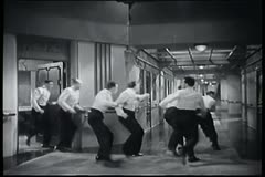 Group of men running down ship corridor Stock Footage