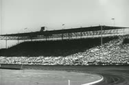 Wide angle view of spectators at race track Stock Footage