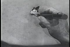 Close-up of hand drawing mischievous animated character Stock Footage