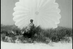 Man struggling with an open parachute Stock Footage