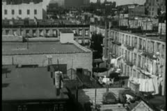 High angle view of 1930s New York City apartment rooftops - stock footage