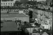 Stock Video Footage of High angle view of 1930s New York City apartment rooftops