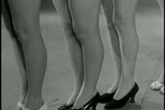 Panning showgirls' legs Stock Footage