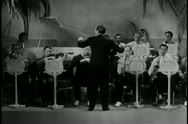 Conductor leading orchestra Stock Footage