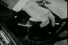 Close-up of man taking needle off record on vintage turntable - stock footage