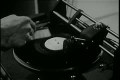 Close-up of man cleaning record on vintage turntable - stock footage