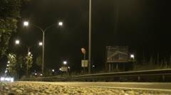 Urban street scene at night Stock Footage