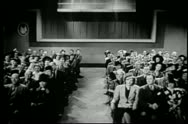 Wide shot of audience listening to lecture Stock Footage