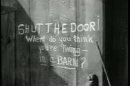 Close-up of closing barn door with message written on it Stock Footage