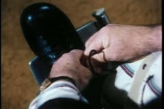 Close-up of man in wheelchair tying his shoe laces Stock Footage