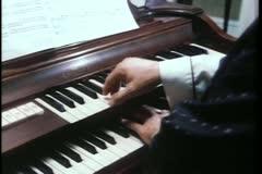 Close-up of man playing an organ - stock footage