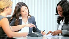 Businesswoman managing multi ethnic female colleagues  - stock footage