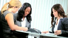 Female diverse colleagues discussing paperwork   Stock Footage