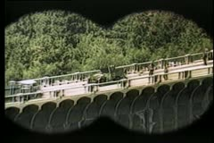 Binocular view of military truck on bridge - stock footage