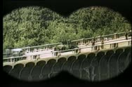 Stock Video Footage of Binocular view of military truck on bridge