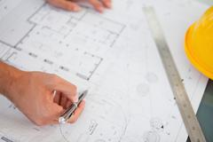 Close up of blueprints with a person making adjustments Stock Photos