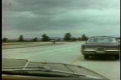 Car driving into oncoming traffic Stock Footage